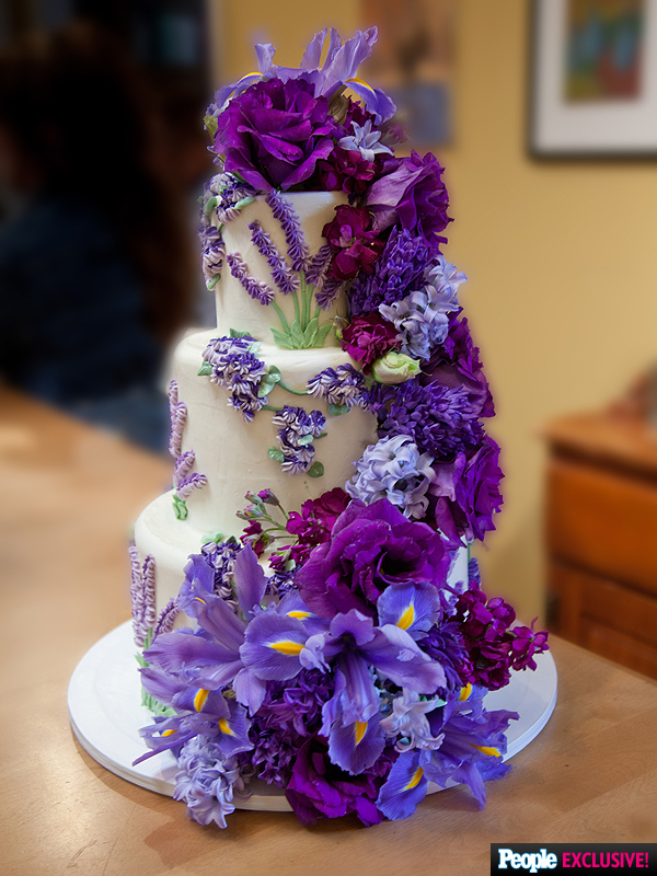 """""""Originally the cake was just supposed to have buttercream flowers, but when it was delivered, I believe the bride wanted cascading fresh flowers added. She had extra flowers at the venue so we just did it onsite and it came out beautiful,"""" says Lockhart. """"I heard she was thrilled!"""""""